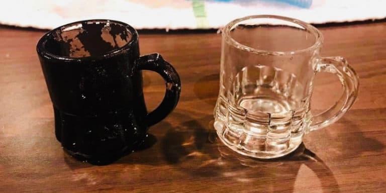 fire damaged glass mug next to cleaned mug
