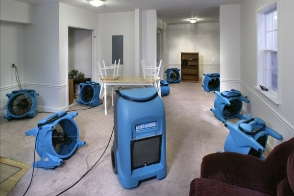 industrial fans airing out water damaged room